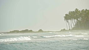 Tropical beach with big waves in slow-motion, telephoto, Dominican Republic stock footage