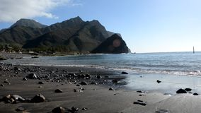 Tropical beach with black sand stock video