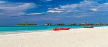 Tropical beach and blue lagoon Royalty Free Stock Photos