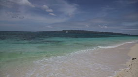 Tropical beach with blue sea stock video footage