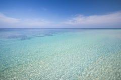 Tropical beach with blue sky and calm blue sea surf Stock Photo