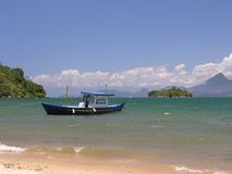 Tropical beach and boat. Brasilian beach located in Angra dos Reis - Rio de Janeiro (Ribeira Beach Royalty Free Stock Photos