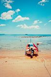 Tropical beach, boat and azure sea in Koh Samui, Thailand Royalty Free Stock Image