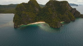 Tropical beach with boats, aerial view. Tropical island. Beautiful beach with boats and tourists. Tropical bay in El Nido. Aerial view: bay and the tropical stock video