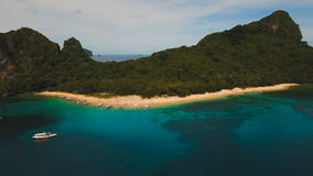 Tropical beach with boats, aerial view. Tropical island. Beautiful beach with boats and tourists. Tropical bay in El Nido. Aerial view: bay and the tropical stock footage