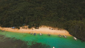 Tropical beach with boats, aerial view. Tropical island. stock video footage