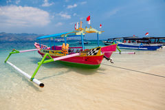 Tropical beach boats. Indonesian boats on tropical beach royalty free stock images