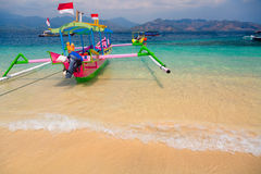 Tropical beach boats. Indonesian boats on tropical beach royalty free stock photography