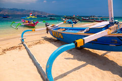 Tropical beach boats. Indonesian boats on tropical sand beach stock image