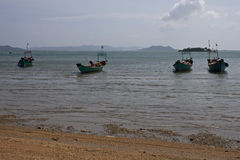 Tropical beach with boats Stock Photos