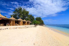 Tropical beach bungalow on ocean shore Stock Photos