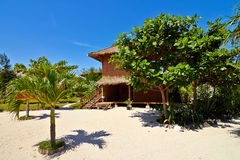 Tropical beach bungalow on ocean shore Royalty Free Stock Photography