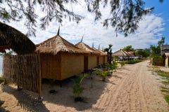 Tropical beach bungalow on ocean shore Royalty Free Stock Photos