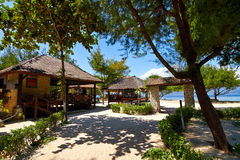 Tropical beach bungalow on ocean shore Stock Photo