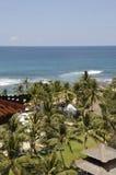 Tropical beach bungalow on ocean shore Stock Photos