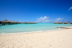 Tropical Beach with Bungalow Royalty Free Stock Image