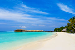 Tropical beach and bungalows Stock Images