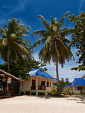 Tropical beach bungalows Royalty Free Stock Photos