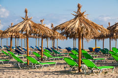 Tropical beach chairs Stock Image