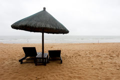 Tropical beach with chairs and parasol Stock Image