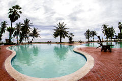 Tropical Beach And Chairs Pool with Palm And Holiday Summer Royalty Free Stock Photos