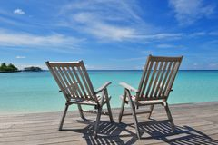 Tropical beach chairs Stock Photography