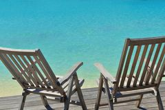 Tropical beach chairs Royalty Free Stock Photography