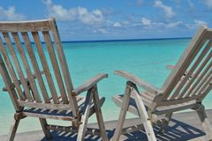 Tropical beach chairs Royalty Free Stock Photo