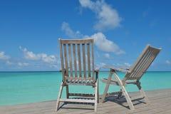 Tropical beach chairs Stock Photos
