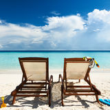 Tropical beach with chaise lounge. At Maldives royalty free stock photos