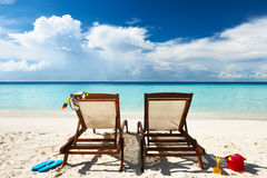 Tropical beach with chaise lounge. At Maldives royalty free stock photography
