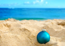 Tropical beach Christmas and New Year background. Merry Christmas and Happy New Year background, Christmas ball on the tropical beach near ocean in Hawaii Stock Photo