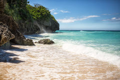 Tropical beach with clear emerald water Stock Photos