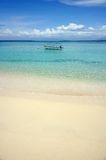 Tropical beach with clear water and boat Royalty Free Stock Photo