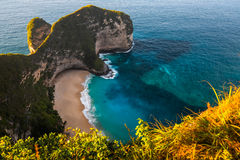 Tropical beach and cliff on the island of Nusa Penida Royalty Free Stock Photo