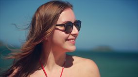 On a Tropical Beach Close-Up Portrait of European Beautiful Cute Brunette in with Sunglass Young Woman or Cheerful Girl stock video footage