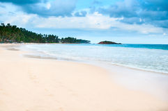 Tropical beach with cloudy dark blue sky. And footprint on yellow sand Royalty Free Stock Photo