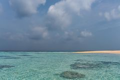 Tropical beach with cloudy sky and clear water Royalty Free Stock Image