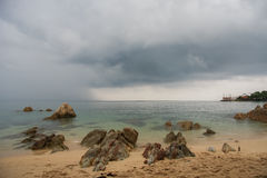 Tropical beach at cloudy and stomy weather in Koh Phangan, Thailand Stock Photo