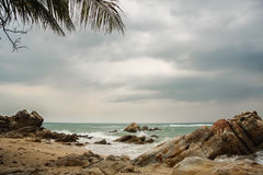 Tropical beach at cloudy and stomy weather in Koh Phangan, Thailand Stock Photos