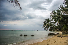 Tropical beach at cloudy and stomy weather in Koh Phangan, Thailand. Tropical beach at cloudy weather in Koh Phangan, Thailand Royalty Free Stock Photos