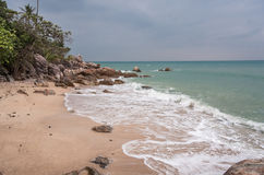 Tropical beach at cloudy and stomy weather in Koh Phangan, Thailand. Tropical beach at cloudy weather in Koh Phangan, Thailand Royalty Free Stock Photography