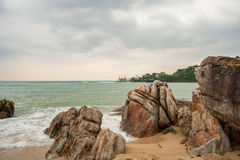 Tropical beach at cloudy and stomy weather in Koh Phangan, Thailand. Tropical beach at cloudy weather in Koh Phangan, Thailand Royalty Free Stock Photo