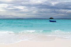 Tropical beach at cloudy weather Royalty Free Stock Image