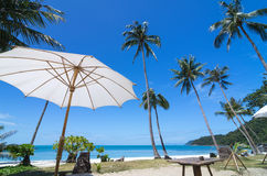 Tropical beach with coconut palm and beautiful umbrella, sa-mui Royalty Free Stock Photo