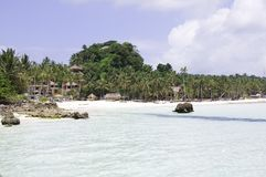 Tropical beach with coconut palm tree. White sand and turquoise sea water, Philippines, Boracay Stock Photography