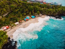 Tropical beach with coconut palms and blue ocean with waves. Aerial view. Tropical beach with coconut palms and blue ocean with waves stock image