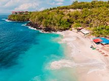 Tropical beach with coconut palms and crystal turquoise ocean in Bali. Aerial view royalty free stock photo