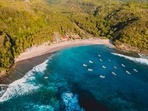 Tropical beach with coconut palms and ocean. Crystal bay, Nusa Penida. Aerial view stock photography
