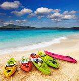 Tropical beach. Colorful kayaks on the tropical beach Royalty Free Stock Images
